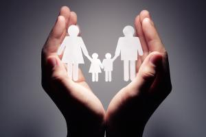 Family Support - Hands holding paper cut-out family